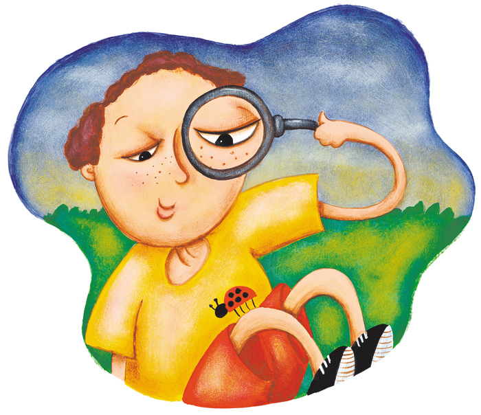 Boy looking at ladybug through magnifying glass