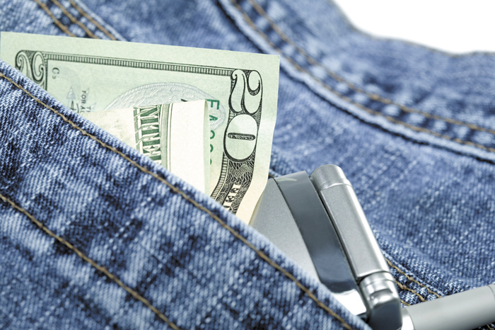 Blue jeans with money and cell phone in pocket