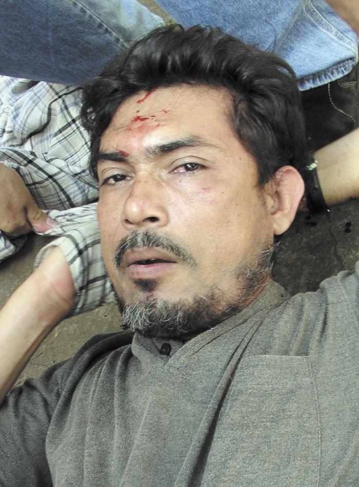 William Hurtado, el asesino de Carlos Guadamuz, poco después de ser capturado. La Prensa/ Foto cortesía Bolsa de Noticias