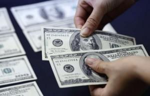 Un dólar costaba, en promedio, 18 córdobas en el año 2006. En la actualidad alcanza los 28.78 córdobas cada dólar. LA PRENSA/ ARCHIVO