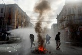 Un muerto en incidentes durante discurso de Bachelet en Chile