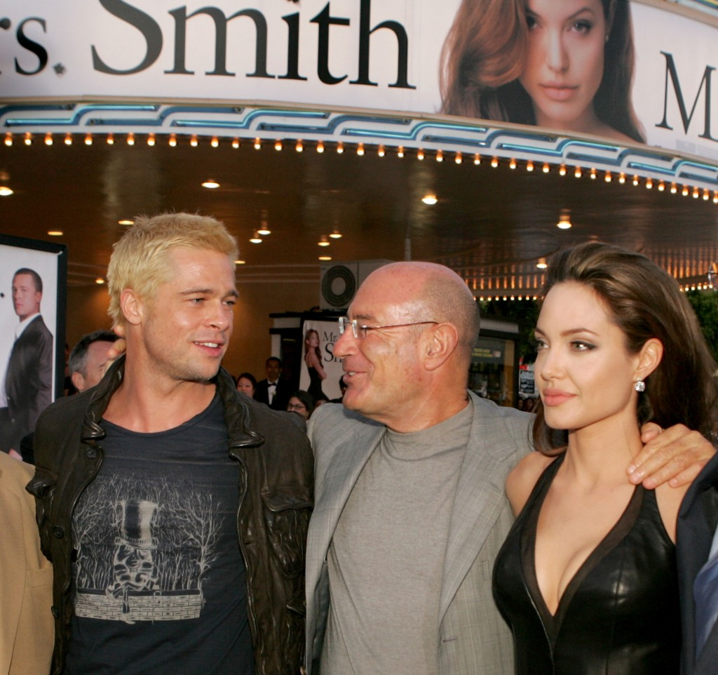 "WESTWOOD, CA - JUNE 07: (L-R) Actor Brad Pitt, Producer Arnon Milchan and actress Angelina Jolie arrive at the premiere of ""Mr. & Mrs. Smith"" at the Mann Village Theater on June 7, 2005 in Westwood, California. (Photo by Kevin Winter/Getty Images)"