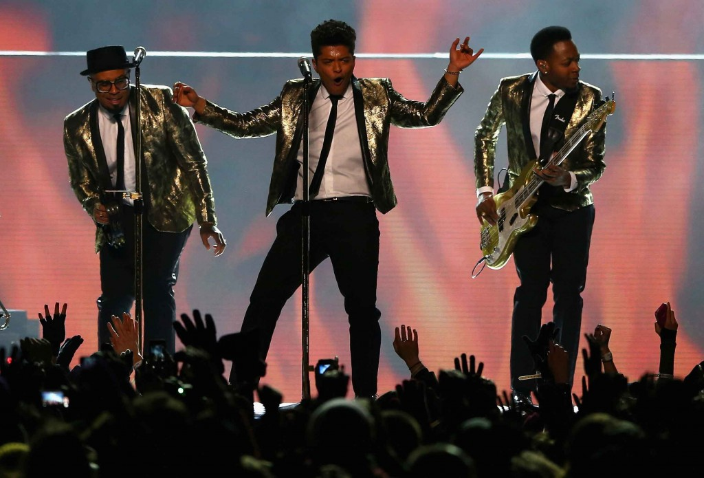 EAST RUTHERFORD, NJ - FEBRUARY 02: Bruno Mars performs during the Pepsi Super Bowl XLVIII Halftime Show at MetLife Stadium on February 2, 2014 in East Rutherford, New Jersey. (Photo by Elsa/Getty Images)