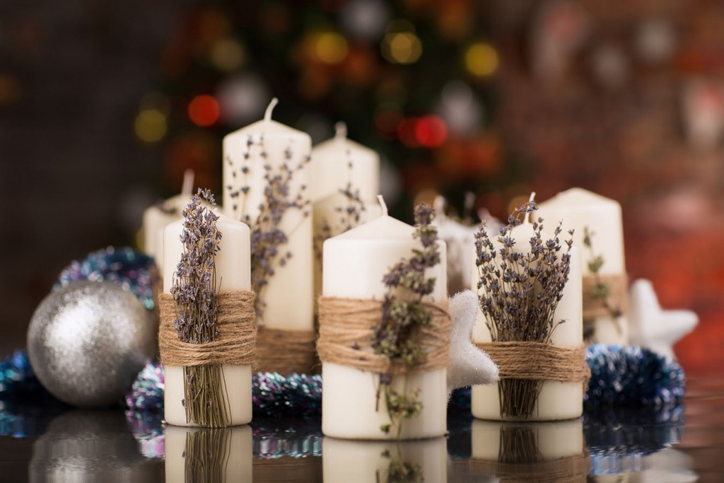 Christmas candles with dry lavender on glass table