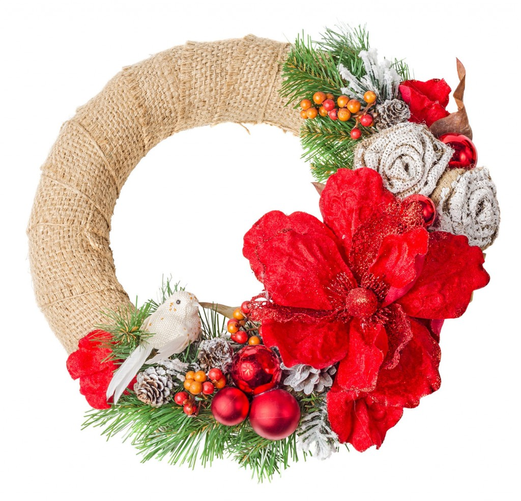 Holly christmas wreath isolated on white background. File contains a clipping path.