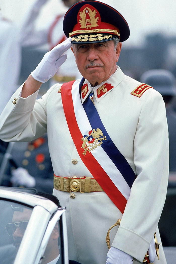 President Augusto Pinochet, saluting, on Armed Forces Day. (Photo by Robert Nickelsberg//Time Life Pictures/Getty Images)