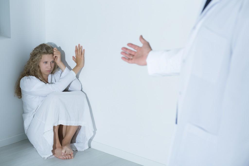 Doctor extending his hand to patient